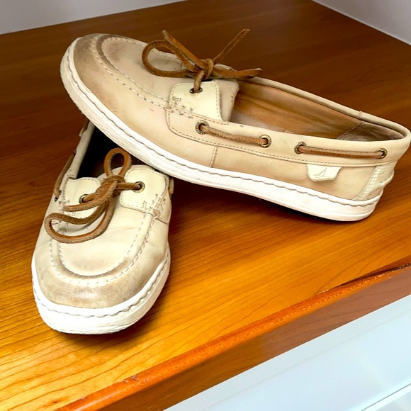Beige and white Sperries